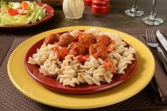 Meatballs and marinara sauce on gluten free pasta Stock Photos