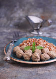 Meatballs of minced meat mixed with buckwheat. Second course: buckwheat with meatballs stock image