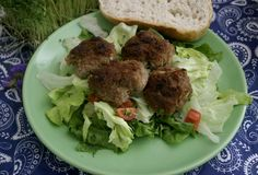 Meatballs of minced meat. Some meatballs of minced meat with a salad Royalty Free Stock Photos