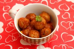 Meatballs of minced meat. Some meatballs of minced meat with a sauce of tomatoes Stock Photography