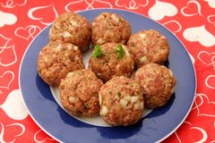 Meatballs of minced meat. Some raw meatballs of minced meat with onions Stock Photo