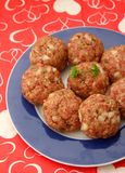 Meatballs of minced meat. Some raw meatballs of minced meat with onions Royalty Free Stock Photo