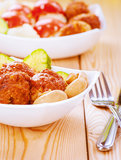 Meatballs and mushrooms in white Stock Image