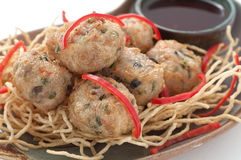 Meatballs with noodles and red paprica Royalty Free Stock Photo
