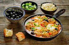 Meatballs with olives and egg in tomato sauce Stock Image