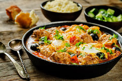 Meatballs with olives and egg in tomato sauce Stock Photo
