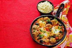 Meatballs with olives and egg in tomato sauce Stock Photos