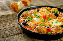 Meatballs with olives and egg in tomato sauce Stock Images