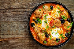 Meatballs with olives and egg in tomato sauce Stock Photography
