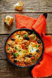 Meatballs with olives and egg in tomato sauce Royalty Free Stock Photo