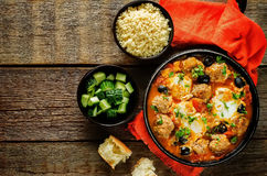 Meatballs with olives and egg in tomato sauce Royalty Free Stock Photography