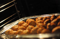 Meatballs in pan. A closeup view of a pan full of meatballs. Black background stock photos