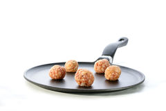 Meatballs in a pan. Five raw meatballs in a pan Royalty Free Stock Photography
