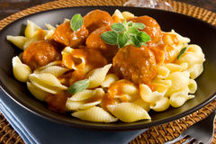 Meatballs and pasta shells stock images