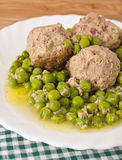Meatballs with peas. Stock Images