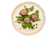 Meatballs with peas from above Stock Image