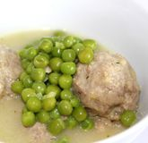 Meatballs with peas Royalty Free Stock Image