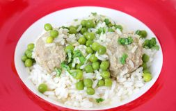 Meatballs with peas Stock Images