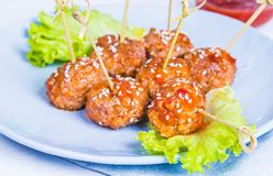 Meatballs in plate. Meatballs in plate with salad royalty free stock image