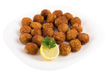 Meatballs. On a plate on a white background and lemon stock photo