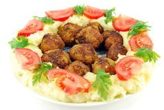 Meatballs with potato and tomatoes Royalty Free Stock Photo