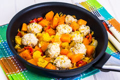 Meatballs poultry with pumpkin and orange in pan on white wooden Royalty Free Stock Photos