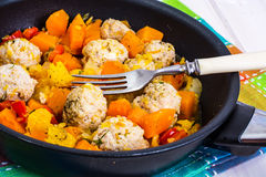 Meatballs poultry with pumpkin and orange in pan on white wooden Stock Photos