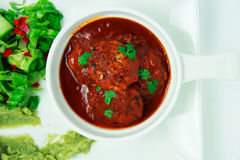Meatballs poured with sweet chili sauce Royalty Free Stock Photos