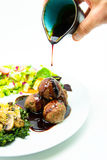 Meatballs poured with sweet chili sauce Royalty Free Stock Photography