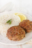 Meatballs with rice and lemon Stock Image