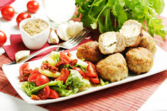 Meatballs with salad garnish Royalty Free Stock Image