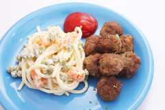 Meatballs with a salad of noodles Stock Photos