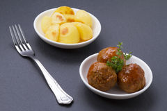 Meatballs with sauce and french fries Stock Image