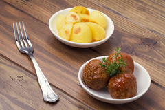 Meatballs with sauce and french fries Stock Photography