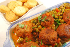 Meatballs in sauce with peas and croutons Royalty Free Stock Photo