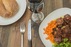 Meatballs in sauce. On the table, glass of wine and bread Royalty Free Stock Photography