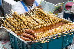 Meatballs and sausages on sticks. Sold at a street market in bangkok, thailand Stock Photos