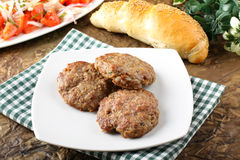 Meatballs served with inslata. On complex background Royalty Free Stock Image