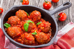 Meatballs smothered in a tomato sauce with basil,garlic,spices Royalty Free Stock Photography