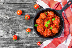 Meatballs smothered in a tomato sauce with basil,garlic,spices Royalty Free Stock Images