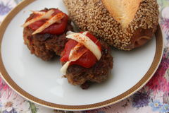 Meatballs. Some meatballs with ketchup and onions Stock Images