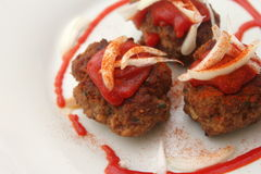 Meatballs. Some meatballs of minced meat with ketchup and onions Stock Photos