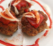 Meatballs. Some meatballs of minced meat with ketchup and onions Stock Photo