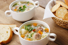 Meatballs soup. Soup with meatballs on the kitchen table Stock Images