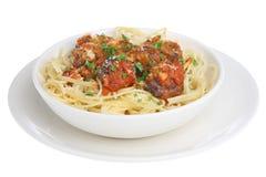 Meatballs & Spaghetti. Italian meatballs in tomato sauce with spaghetti. Isolated on white background Stock Photos