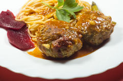 Meatballs with spaghetti and beets on a plate Royalty Free Stock Image