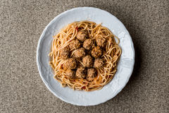 Meatballs with spaghetti bolognese in white plate. Stock Photos
