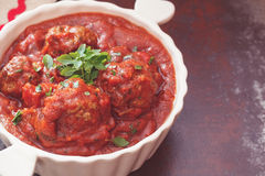 Meatballs with spiced tomato sauce Stock Images