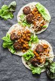 Meatballs, spicy stewed chickpeas and cabbage slaw tortilla -  delicious snack, brunch, appetizers, tapas royalty free stock photography