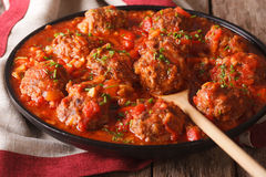 Meatballs with spicy tomato sauce on a dish close-up. horizontal stock photo